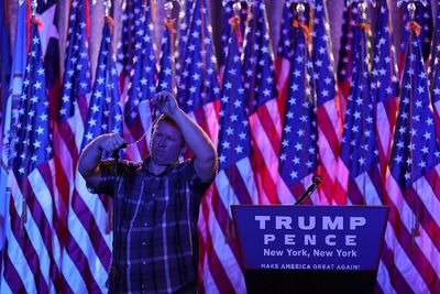 A worker prepares the teleprompter in the election night room for Republican presidential nominee Donald Trump at the New York Hilton Midtown on November 8, 2016 in New York City. Voters head to the polls to decide the next President of the United States.  (Joe Raedle/Getty Images)