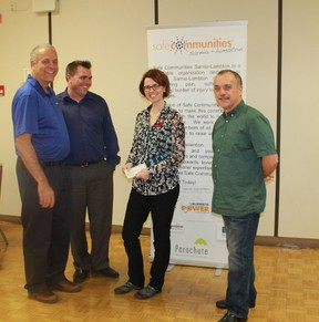 Members of Safe Communities Sarnia-Lambton present a cheque of $450 to Lambton Circles' Megan O'Neil. Left to right: Safe Communities' Mark Roehler and Rob Janoska, Lambton Circles' Megan O'Neil, Safe Communities' Dante Cateni.  CARL HNATYSHYN/SARNIA THIS WEEK