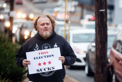 Douglas Hurt holds a sign regarding the 2016 election at the intersection of U.S. 31-W bypass and Broadway Avenue on Election Day, Tuesday, Nov. 8, 2016, in Bowling Green, Ky. (Austin Anthony/Daily News via AP)