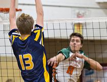 BCI's Alex Bakker (left) tries to block a spike by Matt Bell of North Park on Tuesday during Game 1 a best-of-three senior high school boys championship series. (Brian Thompson/The Expositor)