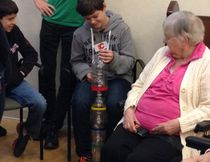 Students visit residents at long-term care facility