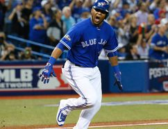 Edwin Encarnacion reacts to his two-run double for the Blue Jays in Game 4 of the American League Championship Series against the Indians in Toronto on Oct. 18, 2016. (Stan Behal/Toronto Sun)