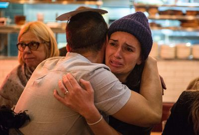An American Democratic Party supporter cries after Donald Trump wins the state of Florida at the Democrats Abroad election night party at Marylebone Sports Bar and Grill on November 8, 2016 in London, England. Photo by Chris J Ratcliffe/Getty Images)