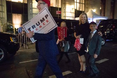 Supporters of President-elect Donald Trump walk past Hillary Clinton's motorcade outside at The Peninsula Hotel in New York, Wednesday, Nov. 9, 2016, after Clinton concedes the election to Donald Trump. (AP Photo/Andrew Harnik)