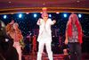 Performer and Cruise Director Eric De Gray, centre, hams it up on stage during a show aboard the Azamara Journey. (PHOTO COURTESY OF MICHELLE GRAHAM PHOTOGRAPHY)