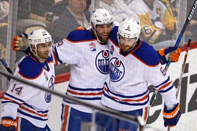 Patrick Maroon, middle, celebrates his goal with teammates Jordan Eberle, left, and Adam Larsson during the first period of Tuesday's game in Pittsburgh. (AP Photo)