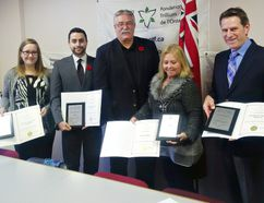 Brant MPP Dave Levac (centre) poses with Becca McLellan (left), WhyNot City Missions, Lonnie Johnson, Habitat for Humanity, Valya Roberts, Dalhousie Place and Philip Sarabura, Brantford Symphony Orchestra, on Wednesday during an announcement of Ontario Trillium Foundation grants. (Vincent Ball/The Expositor)