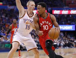 Thunder forward Kyle Singler (15) defends as Raptors guard DeMar DeRozan (10) drives to the basket during first half NBA action in Oklahoma City on Wednesday, Nov. 9, 2016. (Alonzo Adams/AP Photo)
