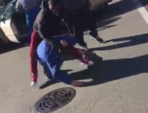A screengrab from a video which shows two young men beating on an elderly man in Chicago. (Twitter)