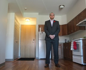 Josh Bode stands in his apartment at 77 Tecumseh Ave. W. in London, a recently built affordable housing unit featuring high ceilings, an open-concept kitchen and spacious balcony. ?It has everything I need,? said Bode. (DALE CARRUTHERS, The London Free Press)