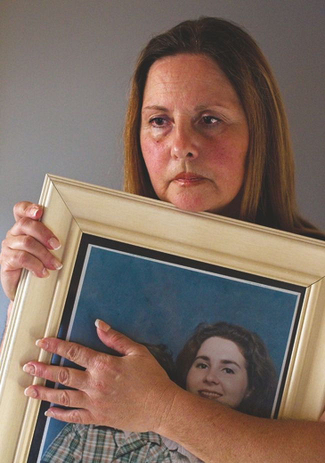 In a photo taken on Aug. 15, 2012, Wendy Yurko is seen holding a photo of her daughter Dana Turner, who was murdered, in her home in Fort Saskatchewan. Mark Lindsay, Turner's ex-boyfriend, admitted to her murder during his aggravated-assault trial in a B.C. court.