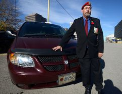 Veteran John Collins parked in the Impark parking lot at York and Clarence streets to attend a Veterans Appreciation event at a London Knights game at Budweiser Gardens and was shocked to see he had a parking ticket. Impart had been granting free parking to veterans with a poppy licence plate but has recently changed their policy. Photo taken on Thursday Nov 10, 2016. (MORRIS LAMONT, The London Free Press)