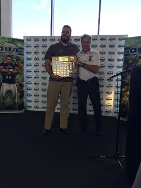 Western offensive lineman Sean Jamieson shows off his hardware with Mustangs head coach Greg Marshall after being named winner of the J.P. Metras Trophy on Thursday in Burlington. (MORRIS DALLA COSTA, The London Free Press)