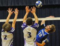 Dallas Hunter of the Simcoe Sabres senior boys volleyball team, right, unleashes a spike against the Valley Heights Bears in Wednesday's Norfolk County championship final. SCS needed the maximum five games to win the title. MONTE SONNENBERG/SIMCOE REFORMER