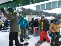 Snowboarders get ready to jump on the chairlift at Sunshine Village on the ski and snowboard resort's opening day on Thursday. The opening was the resort's earliest in 30 years. (Lindsay Gallagher/ Courtesy of Sunshine Village Ski Resort)