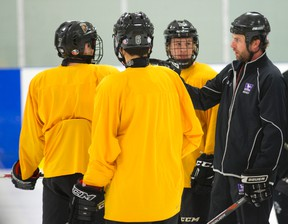 Junior Knights minor midget head coach Steve Benedetti talks to top line during a practice at the Western Fairs Sports Centre. (Free Press file photo)