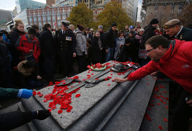 <p>Members of the public lay poppies at the Tomb of the Unknown Soldier during Remembrance Day ceremonies in Ottawa on Friday, November 11, 2016.</p><p> Patrick Doyle/Postmedia Network