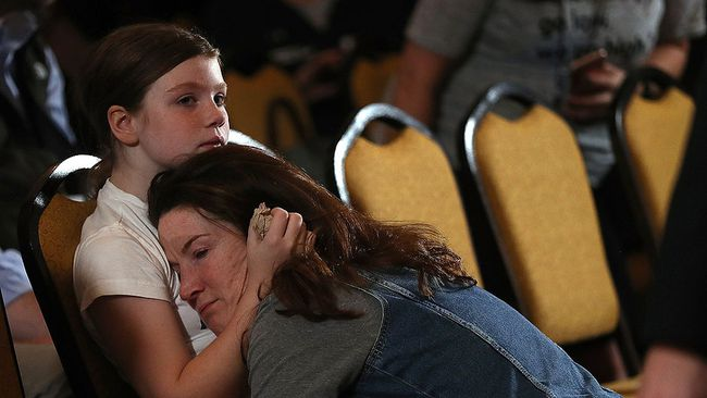Supporters embrace as they wait for Hillary Clinton to deliver remarks to supporters and staff at the New Yorker Hotel on Nov. 9, 2016 in New York City. (Justin Sullivan/Getty Images)