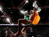 Conor McGregor celebrates his KO victory over Eddie Alvarez in their lightweight championship bout during the UFC 205 event at Madison Square Garden on Nov. 12, 2016 in New York City. (Michael Reaves/Getty Images)