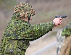 Pte. William Fyfe of the Princess of Wales Own Regiment takes part in the pistol marksmanship event while trying to earn his second German Armed Forces Badge for Military Proficiency at CFB Kingston on Saturday. (Steph Crosier/The Whig-Standard)