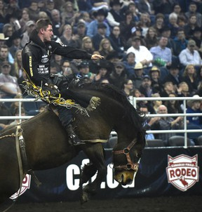 Jake Vold rode to victory on Reckless Margie Sunday at the Canadian Finals Rodeo at Northlands Coliseum. (Ed Kaiser)