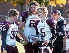 Wallaceburg Tartans captains Dylan Hiltz, left, Camden Fischer, Tanner Cole and Brodie Genyn receive the LKSSAA 'AA' junior football championship plaque from Tom Peel on Saturday at Wallaceburg District Secondary School. (DAVID GOUGH/Postmedia Network)