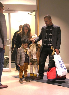 The Alkhateeb family arrives at Kingston's airport. The family includes parents Lina and Fares, son Jamal, 4, and daughter Reem, 6. (Lorraine Payette/Special to Postmedia Network)