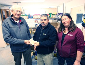 Bearing a gift of more than $1,600 in cash for the Seaforth and District Food Bank, the Family Paradise Campground has done there good deed before Christmas. From the left are SDFB, committee chair, Bob McDowell, FPC managers, Mike and Cathy Mulholland.(Shaun Gregory/Huron Expositor)