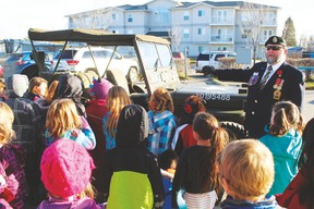 Former Infantryman and Retired Captain Paul Spurrell shows off the army jeep he acquired from a museum in British Columbia. While in the Armed Forces, Spurrell was quite used to driving this type of jeep and has owned it for the past five years. Looking on are students from Eldorado School. Spurrell was busy throughout the day serving as guest speaker at the schools in town as they held their Remembrance Day ceremonies throughout the day.