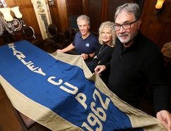 Mike Wilson, from left, Deb Thuet and Wayne Parsons hold the original 1962 Stanley Cup banner that hung in Maple Leaf Gardens on Tuesday, November 15, 2016 in Toronto. (Dave Abel/Toronto Sun)