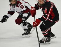 QRD atom minor skater Rylan McCormack carries the puck in recent AAA hockey action. (Photo submitted)