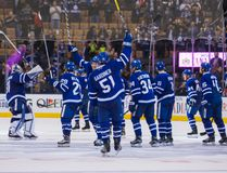 Maple Leafs players raise their sticks to salut the fans after beating the Predators at the Air Canada Centre in Toronto on Tuesday, Nov. 15, 2016. (Ernest Doroszuk/Toronto Sun)