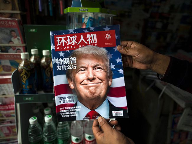 "A copy of the local Chinese magazine Global People with a cover story that translates to ""Why did Trump win"" is seen with a front cover portrait of U.S. president-elect Donald Trump at a news stand in Shanghai on November 14, 2016. (JOHANNES EISELE/AFP/Getty Images)"