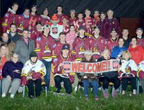 """Timmins Rock players, coaches and trainers joined staff and residents of Golden Manor as part of the facility's """"paint the town red"""" celebrations for the arrival of Rogers Hometown Hockey in Timmins next weekend. The statue in front of Golden Manor has been decorated with a hockey theme, demonstrating the love staff and residents have for the sport. THOMAS PERRY/THE DAILY PRESS"""