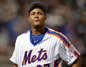 In this May 29, 2016, file photo, New York Mets relief pitcher Jeurys Familia reacts as walks off the field during the ninth inning of the baseball game against the Los Angeles Dodgers at Citi Field in New York. (AP Photo/Seth Wenig, File)