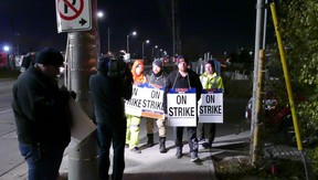 A small protest ensued after garbage workers in Peel Region went on strike and workers brandished signs at a gas station on Britannia Rd. south of the intersection of Atlantic Ave. in Mississauga.(Pascal Marchand photo)