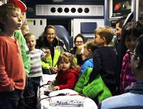 PAUL KRAJEWSKI HIGH RIVER TIMES/POSTMEDIA NETWORK. Emergency Medical Services (EMS) personnel exhibit the inside of an ambulance to children and male role models at the most recent Dad's Central event that was held at the fire hall in High River, Alta., on Nov. 17.