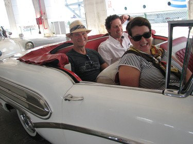 Postmedia Network's Jane Stevenson, front, Doug Cooke, left, and Justin Kavanagh go for a spin around Havana in a '58 Buick convertible.