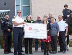 Organizers of the North American Police Equestrian Championships hand over a $20,000 cheque to the United Way of Kingston, Frontenac, Lennox and Addington at Police Headquarters on Wednesday. (Steph Crosier/The Whig-Standard)