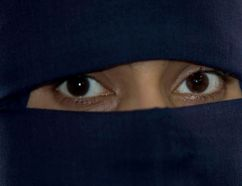 A Muslim woman wearing a niqab, a headdress that essentially covers everything but the eyes, is pictured in this file photo. (Postmedia Network file photo)