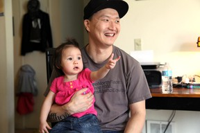 In this March 19, 2015, file photo, Korean adoptee Adam Crapser poses with daughter, Christal in the family's living room in Vancouver, Wash. The immigration attorney for Crapser, who was adopted from South Korea almost four decades ago and flown to America, says he has been deported. U.S. Immigration and Customs Enforcement ordered Adam Crapser be deported because of criminal convictions including assault and being a felon in possession of a weapon. (AP Photo/Gosia Wozniacka, File)