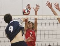 Stratford Central Rams Evan Moorehead (7) and Hayden Cavender (12) go for a block against Parkside's Clayton Sturk during the WOSSAA senior boys volleyball final Thursday at Central. The Rams won in three sets to advance to OFSAA. Cory Smith/The Beacon Herald