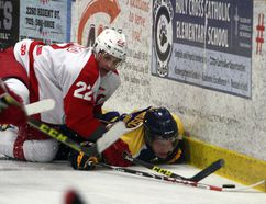 Laurentian Voyageurs' Elliott Richardson is taken to the ice by RMC defender Eric Bouchard during OUA men's hockey action at Gerry McCrory Countryside Sports Complex in Sudbury, Ont. on Saturday, Nov. 19, 2016. Ben Leeson/The Sudbury Star/Postmedia Network