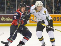 London Knights forward Max Jones battles with Luke Boka of the Windsor Spitfires during the first period of London's 3-2 overtime win Nov. 20, 2016 at Budweiser Gardens. (DEREK RUTTAN, The London Free Press)