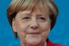 German Chancellor and chairwoman of the Christian Democratic party, Angela Merkel, addresses the media in Berlin, Germany, Sunday, Nov. 20, 2016. Chancellor Merkel said that she will run for a fourth four-year-term to become one of the longest-serving leaders of post-war Germany. (AP Photo/Markus Schreiber)