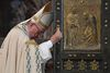 Pope Francis closes the Holy Door of St. Peter's Basilica at the Vatican, Sunday, Nov. 20, 2016, marking the end of the Jubilee of Mercy. (Tiziana Fabi/pool photo via AP)