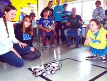 During Michelle McDonald's Grade 8 class' Robot Olympics at Mitchell District High School (MDHS) last Thursday, Nov. 17, Madalyn Smith and Olivia Burlock cheer on their robot Moopbot as it pushes Malia Glanville and Kyla Horton's robot DKML out of the ring in the sumo event. GALEN SIMMONS MITCHELL ADVOCATE