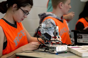 Grade 7 student Amber Morton from Roch Carrier French Immersion School in Woodstock works on her team's robot at the 11th annual Robotics Challenge at Goff Hall on Tuesday. (BRUCE CHESSELL/Sentinel-Review)