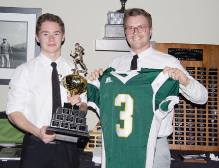 Canmore Wolverines head coach Wade Buckley (right) presents the Most Valuable Player award to Jackson Howatt during the high school football team's annual awards banquet on Thursday at the Canmore Golf and Curling Club. Russ Ullyot/ Crag & Canyon