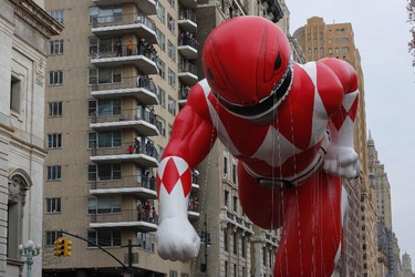 The Red Ranger balloon flies over Central Park West avenue during the 90th annual Macy's Thanksgiving Day Parade on November 24, 2016 in New York. (KENA BETANCUR/AFP/Getty Images)